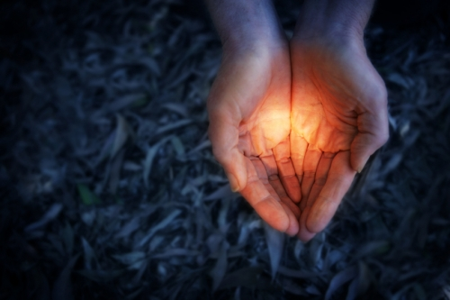 hands with light