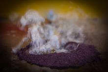 Purple powder and smoke.