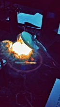 Smoke and light in a bowl with cover removed.