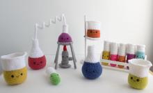 Crocheted beakers, test tubes and Bunsen burner.