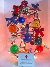 Christmas tree made of colourful flasks and bows.