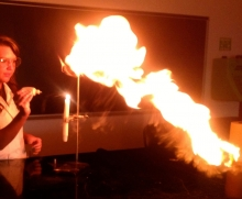 Student creating flame from test tube.