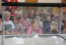 Young students mesmerized by bubbles.