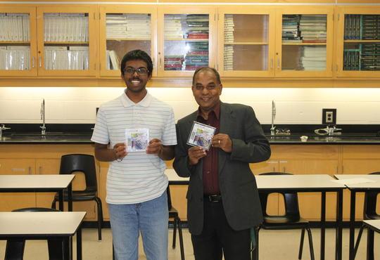 Top North American student holding Chem 13 News exam tile award