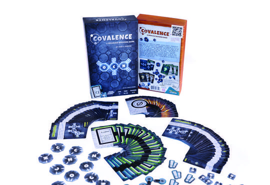 Covalence: A molecular building game. Front and back of box, plus contents displayed.