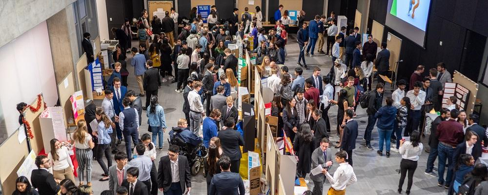 Students, faculty and visitors mingle at the CHE 180 Design Symposium.