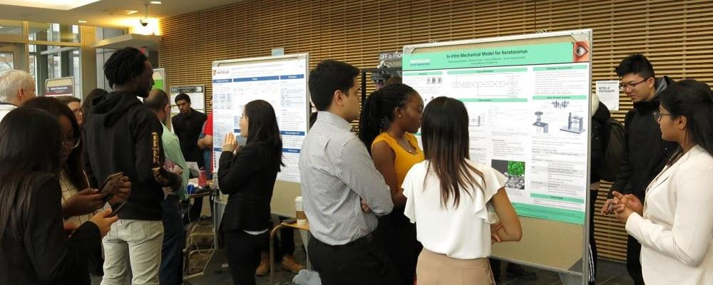 Students view posters at Chemical Engineering's 2019 Capstone Design Symposium.