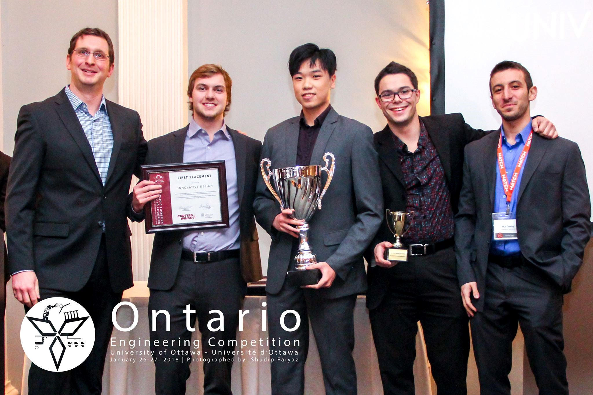 A judge for the 2018 Ontario Engineering Competition's Innovative Design category congratulates Waterloo chemical engineering st