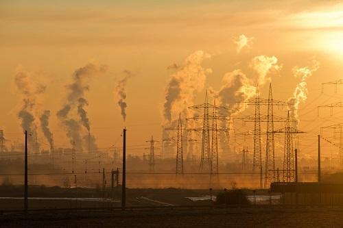 Industrial air pollution with CO2 emissions rising into the atmosphere and changing our climate