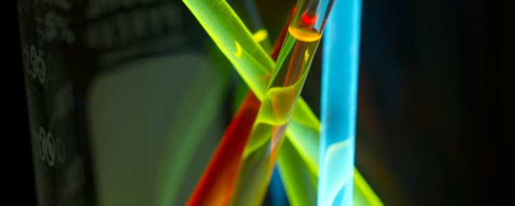 coloured test tubes in a beaker