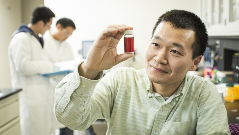 Juewen Liu in his lab, testing for water contaminants.