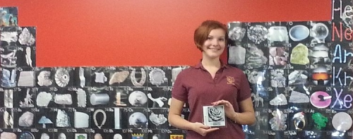 student with award tile