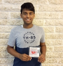 High school student with award tile