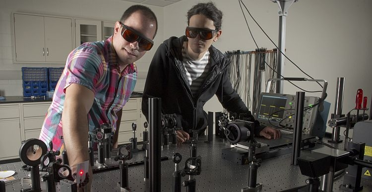 chemistry professor and student with laser equipment