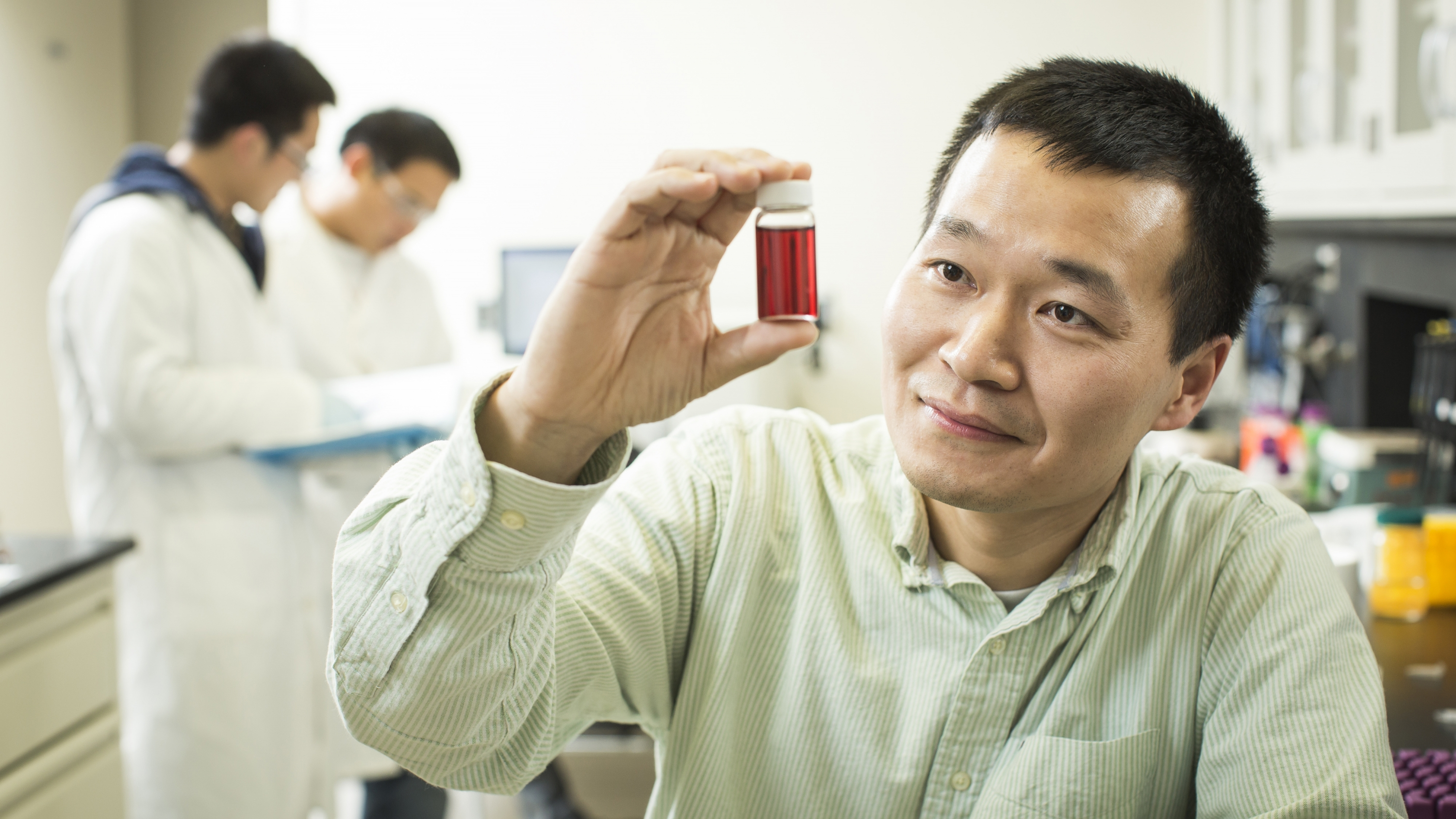 Liu in his lab testing for water contaminants.