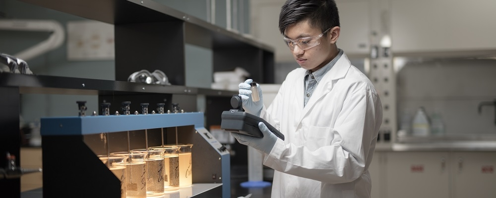 Environmental Engineering student in a lab