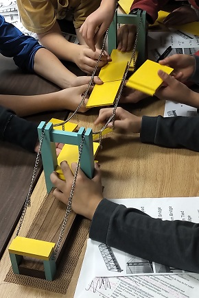 Students building a bridge