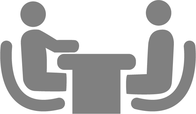 Icon of two people interviewing at a desk