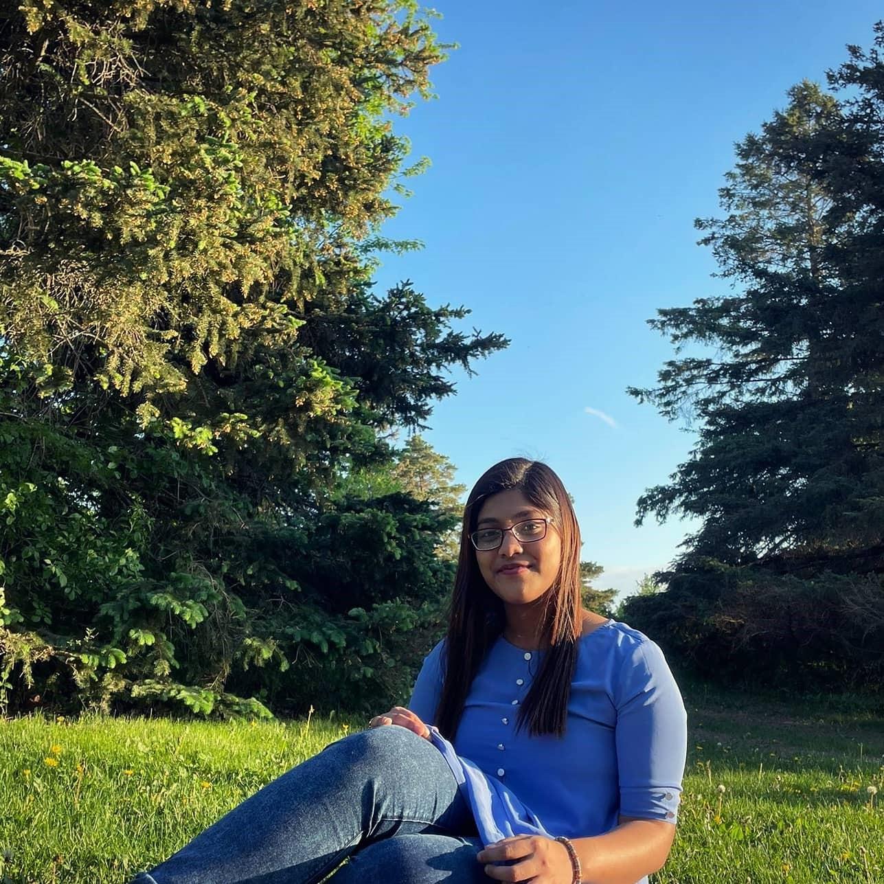 Priyanka sitting on the grass