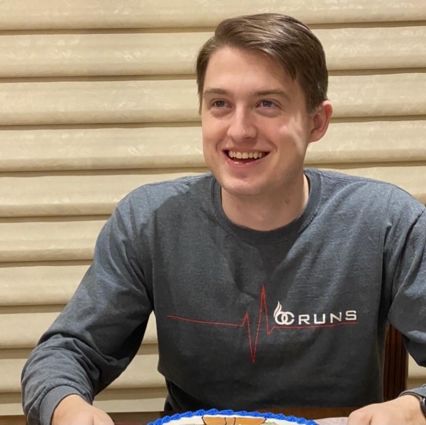 Adam smiling