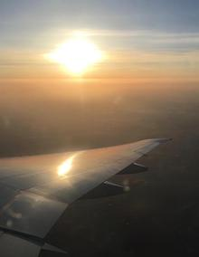 Airplane wing underneath the sunrise
