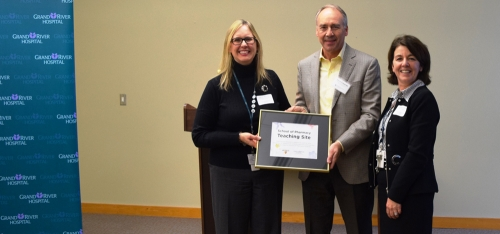 Grandriver and University reps smile together to celebrate partnership