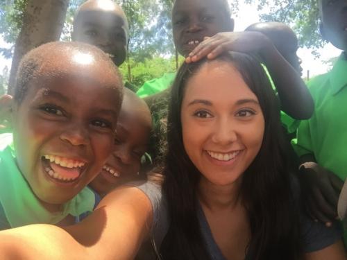 Student with peers in Kenya