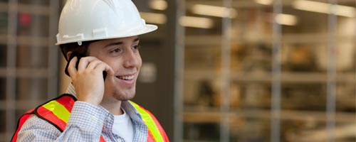 Architecture co-op student in hard hat and safety vest