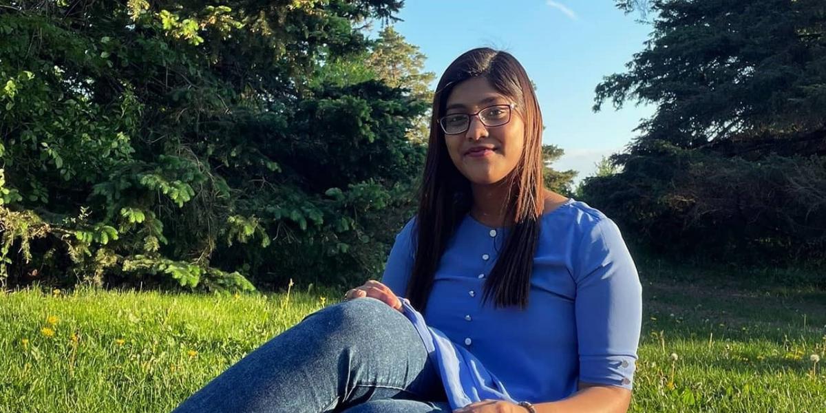University of Waterloo, Math Co-op student, Priyanka Saha sitting on grass