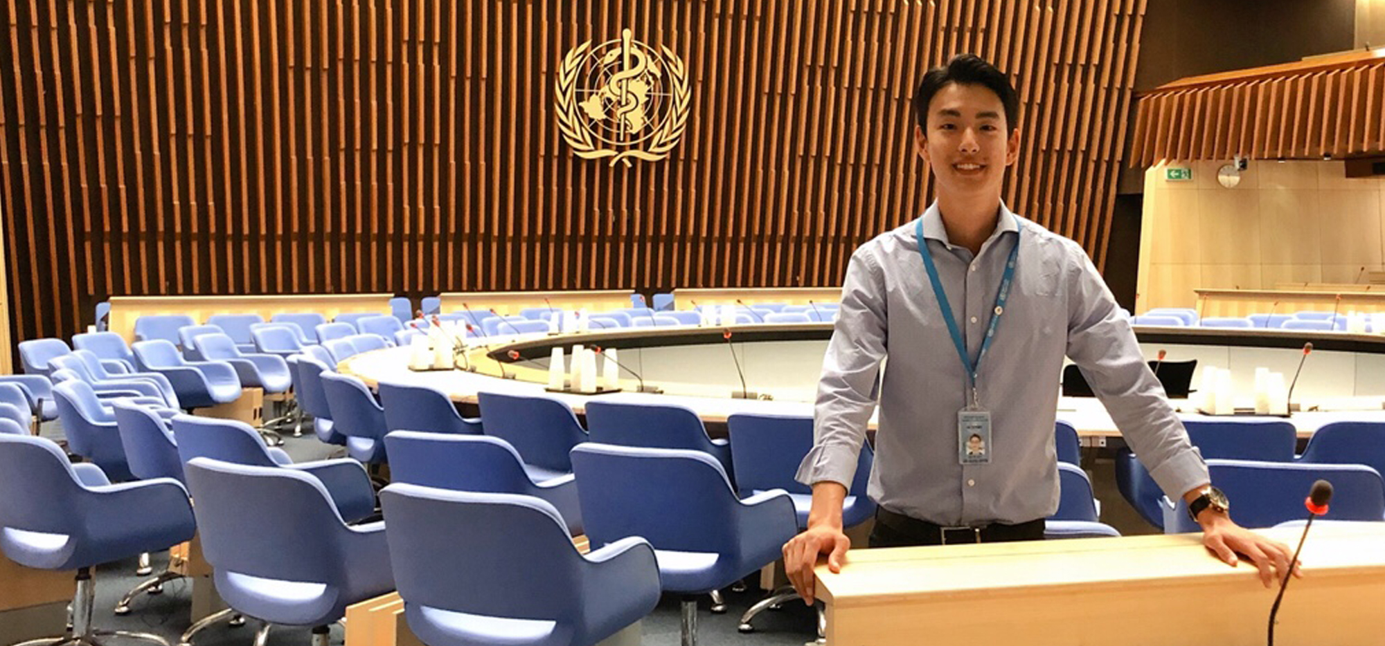 John Kim standing inside the World Health Organization buildng