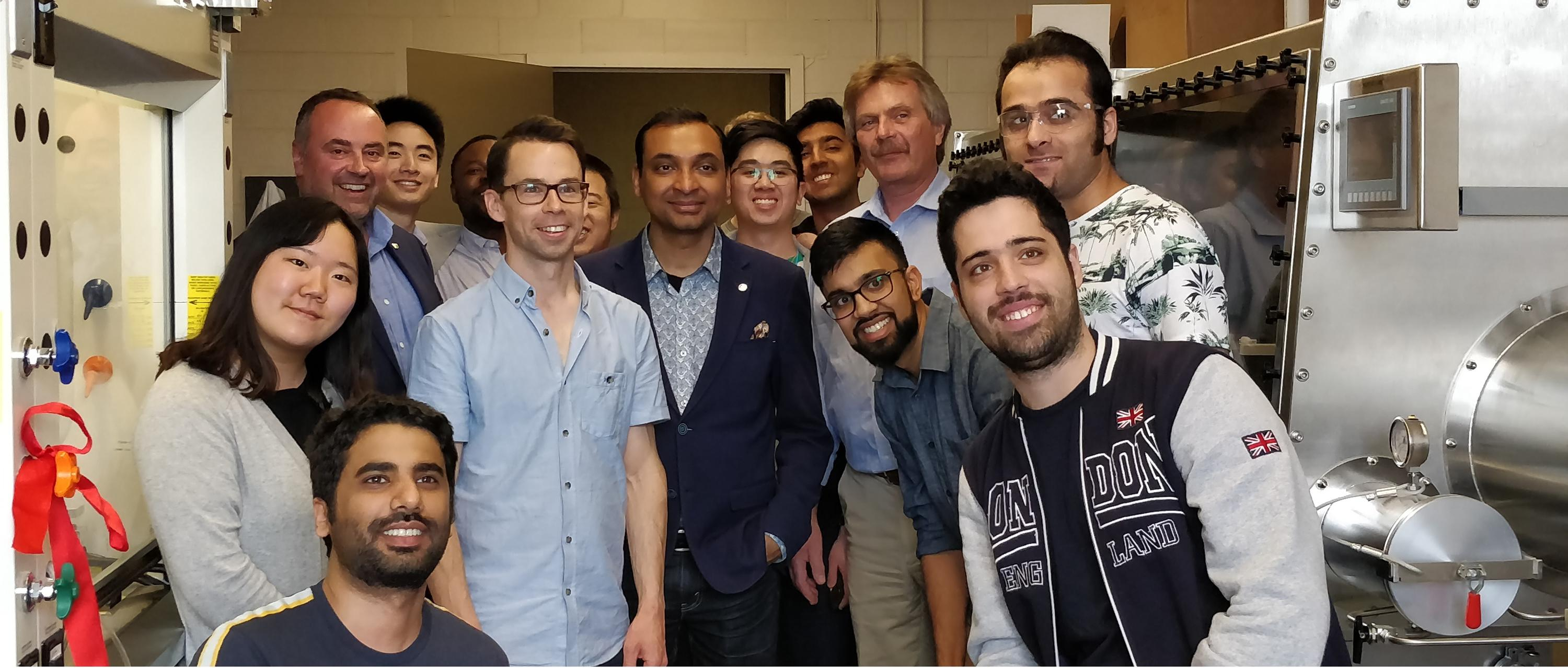 Students and professor Kevin Musselman pose with ribbon cutters Sushanta Mitra, Jan Huissoon and Ross Johnston