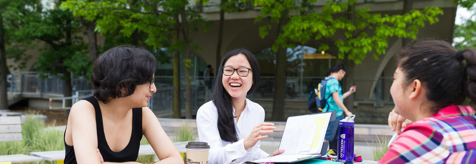 students having coffee on campus