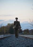 Solider walking a train track