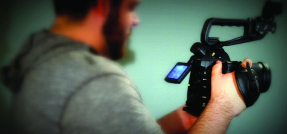 Man holding camera equipment