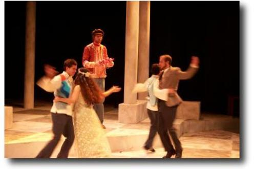 Group of people dancing in pairs on stage