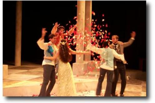 Group of people throwing confetti in the air on stage