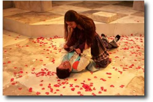 Woman lying on top of a man surrounded by confetti