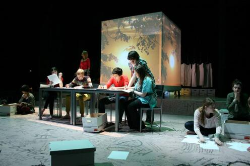 Actors work at table
