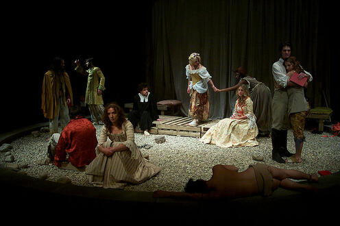 Group of people on stage in the play 'Our Country's Good'
