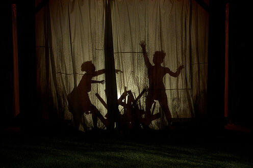 Shadows of people in the play 'Our Country's Good'