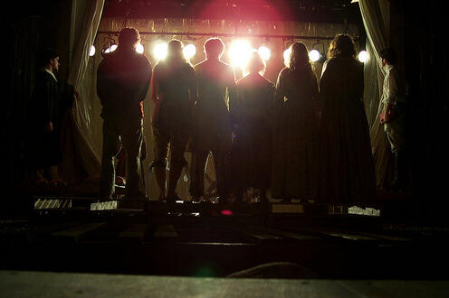 Silhouettes of six people in the play 'Our Country's Good'