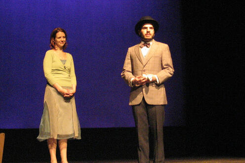 Man and woman on stage