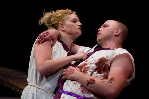 Woman stabbing a man in the play 'Julius Caesar'