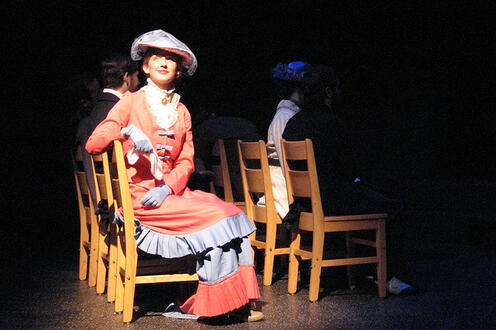 Woman sitting on stage