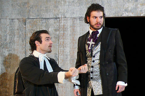 Two men standing in costumes in the play Tartuffe