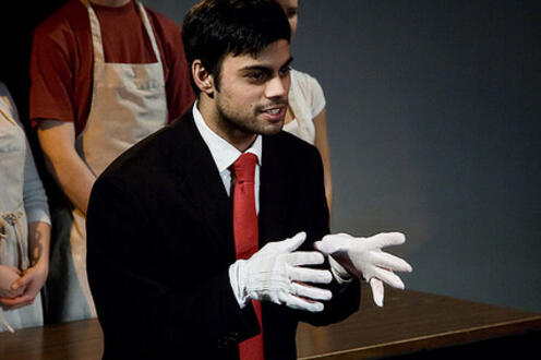 Man wearing gloves and speaking