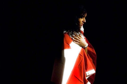 Girl draped in a Canadian flag
