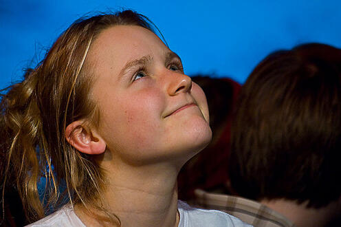 Girl smiling and looking to the sky in the play Differ/End: The Caledonia Project