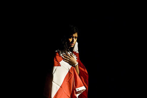 Girl standing draped in a Canadian flag