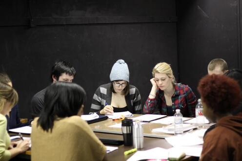 Actors sit around table